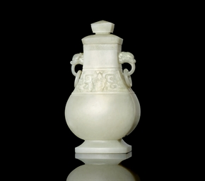 A SMALL WHITE JADE BALUSTER VA