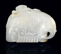 A WHITE JADE MODEL OF AN ELEPHANT AND BOY