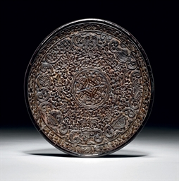 A RARE FINELY CARVED LACQUER D