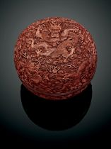 A LARGE LACQUER 'NINE DRAGON' BOX AND COVER