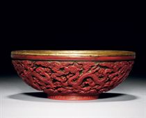 A FINELY CARVED CINNABAR LACQUER BOWL