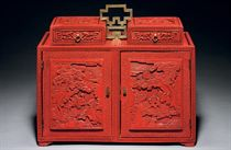A WELL-CARVED CINNABAR LACQUER TABLE CABINET
