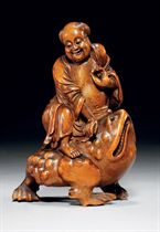 A BAMBOO CARVING OF LIU HAI AND HIS TOAD