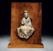A MOUNTED STONE FRAGMENT OF A SEATED BODHISATTVA