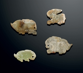 FOUR JADE 'RABBIT' PENDANTS