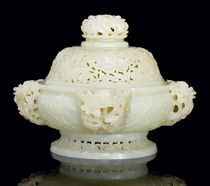 A VERY PALE CELADON JADE RETICULATED BOMBÉ CENSER AND COVER
