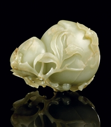 A FINE CELADON JADE CARVING OF