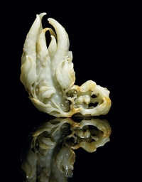 A FINELY CARVED JADE FINGER CI