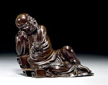 A FINELY CARVED LACQUERED-WOOD FIGURE OF DAMO