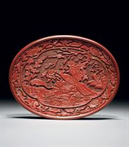 A FINELY CARVED CINNABAR LACQUER OVAL DISH