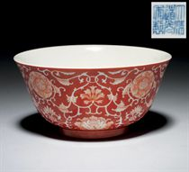 A CORAL-GROUND REVERSE-DECORATED 'LOTUS' BOWL