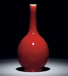 A RED-GLAZED BOTTLE VASE