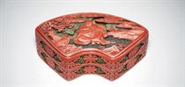 A FAN-SHAPED CARVED POLYCHROME CINNABAR LACQUER BOX AND COVE