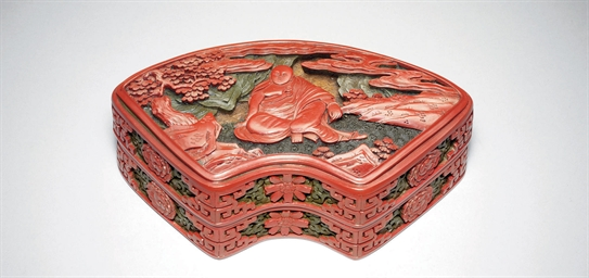 A FAN-SHAPED CARVED POLYCHROME
