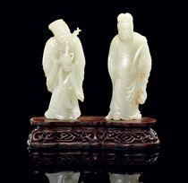 TWO CELADON JADE MODELS OF IMMORTALS