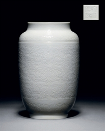 A RARE CARVED WHITE-GLAZED LAN