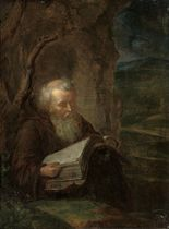A hermit saint reading in a landscape