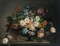 Tulips, roses, carnations and other flowers in an urn on a stone ledge with a sprig of roses