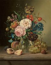 Irises, tulips, peonies, roses and other summer blooms in a glass vase on a marble ledge surrounded by peaches, grapes and plums