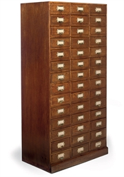 A TALL OAK CHEST