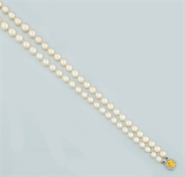 A cultured pearl, yellow sapph