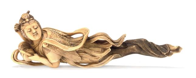 An Ivory sashi-style Netsuke