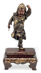 A Bronze Okimono [Sculptural O