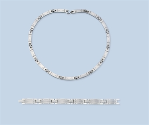 A DIAMOND NECKLACE AND BRACELE