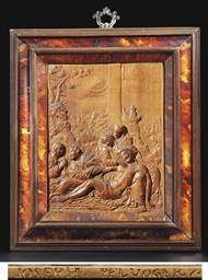 A RECTANGULAR CARVED FRUITWOOD
