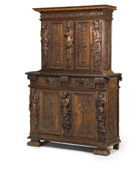 A FRENCH CARVED WALNUT MEUBLE
