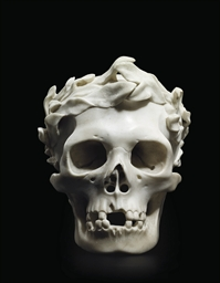 A CARVED MARBLE SKULL