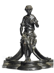 A BRONZE FIGURE OF A SEATED FE