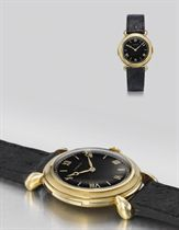 E. Gübelin. A very fine and rare mid-size 18K gold minute repeating wristwatch with black dial