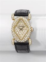 Moussaieff. A fine and unusual 18K gold and diamond-set oval wristwatch