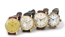 A lot of four gold chronograph wristwatches