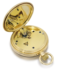 English. An 18K gold openface