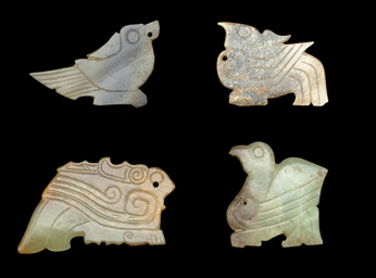 THREE EARLY JADE BIRD PENDANTS