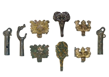 A GROUP OF NINE BRONZE FITTING