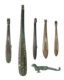 A GROUP OF SIX BRONZE BELT HOO