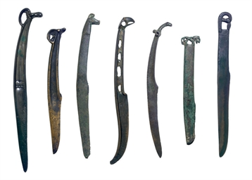 A GROUP OF SEVEN BRONZE KNIVES