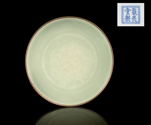 AN INCISED CELADON DRAGON DISH