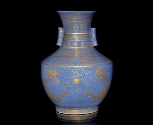 A GILT DECORATED BLUE GLAZED H