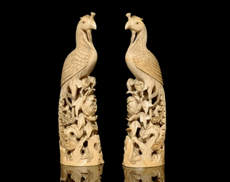 A PAIR OF IVORY CARVINGS OF PH