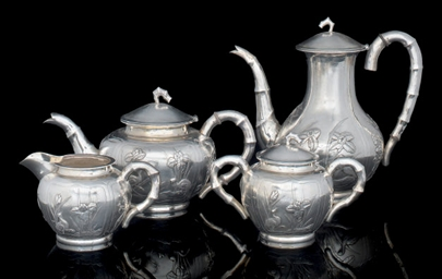 A FOUR PIECE SILVER TEA AND CO