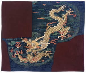 A LARGE BROCADE DRAGON PANEL