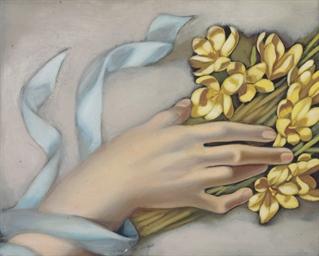 Main tenant une gerbe de fleur