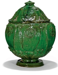 A CHINESE GREEN GLAZED 'BUDDHIST' JAR AND COVER