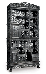 A CHINESE CARVED EBONISED HARD