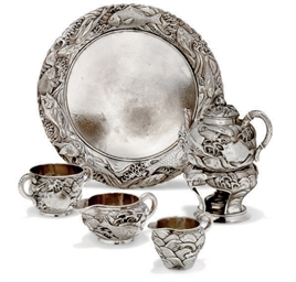 A JAPANESE SILVER PART TEASET