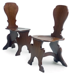 A PAIR OF MAHOGANY HALL CHAIRS